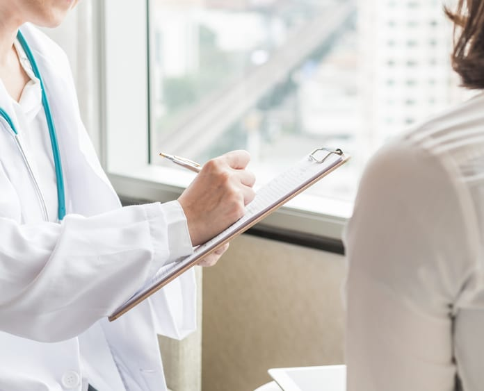 Psychiatrist meeting with patient in a hospital setting
